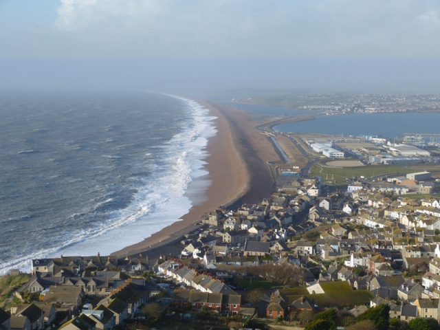 Chesil Beach, a natural barrier, is thrashed by storms every winter