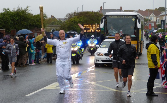 It was still raining when the Olympic torch arrived on 12 July.