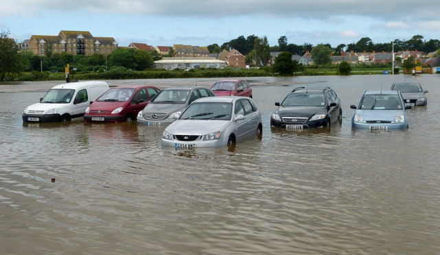 Unseasonal rain meant that a week into July parts of Weymouth were under water.