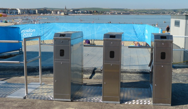 The curious sight of turnstiles for the beach. It was free to enter.