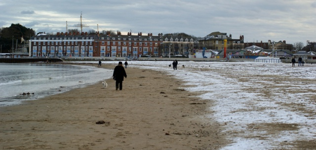 Winter occasionally brings the sight of snow on the beach